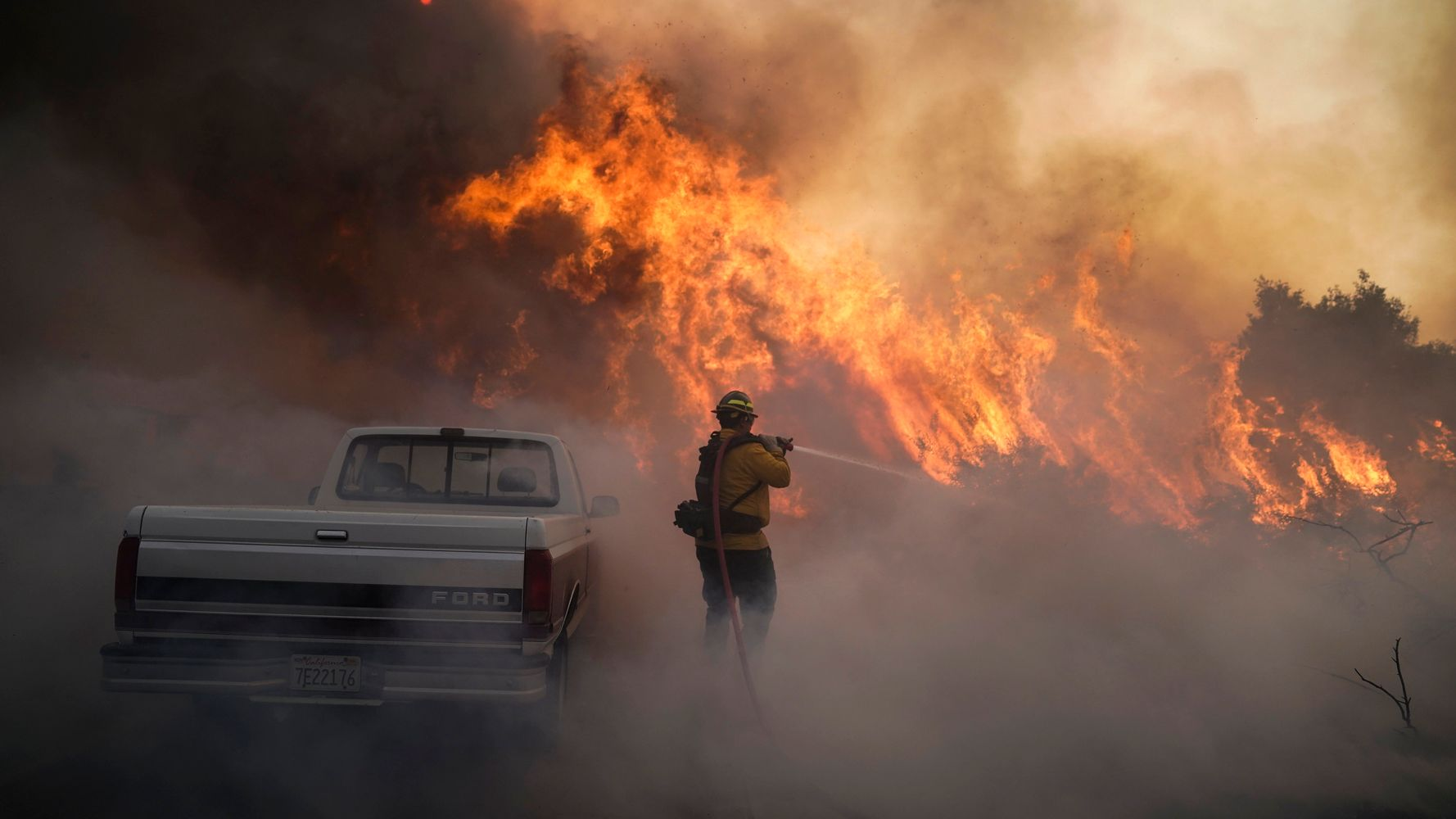 Tens Of Thousands Evacuated In Southern California As Out-Of-Control Wildfires Rage
