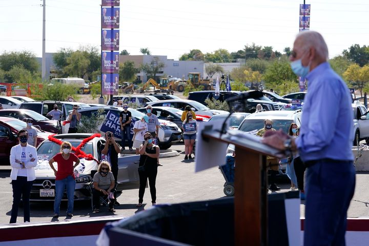 Supporters watch as Democratic presidential nominee Joe Biden speaks at a Las Vegas drive-In campaign event on Oct. 9.
