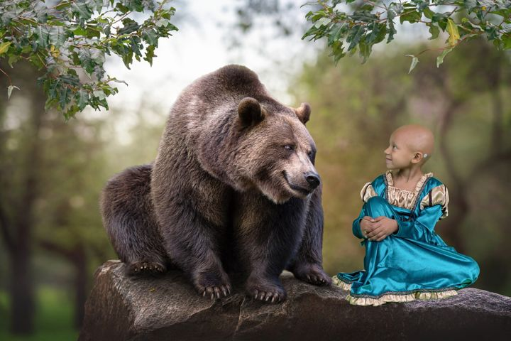 """Arianna faces off with a bear as Merida from """"Brave."""""""