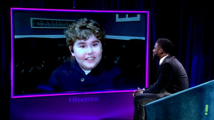 Kevin Hart talks to Ethan Lybrand, a child with a neuromuscular disability.