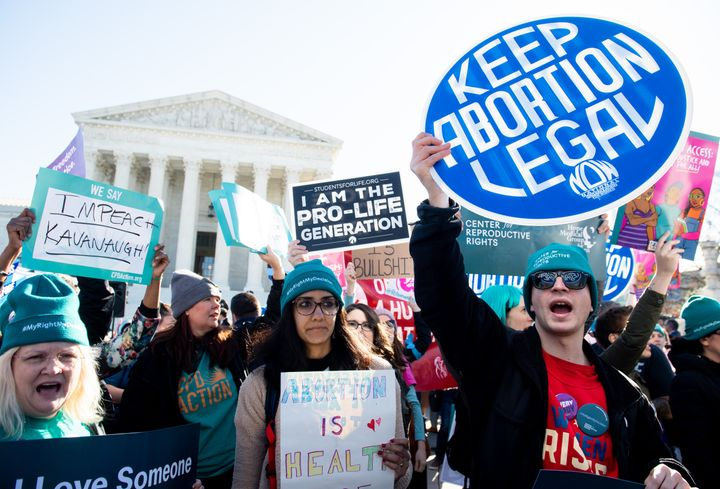 Pro-choice and anti-abortion activists clash outside the U.S. Supreme Court in March ahead of a hearing on another Louisiana