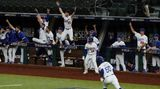 Los Angeles Dodgers' Mookie Betts rounds the bases after a home run against the Tampa Bay Rays during the eighth inning in Game 6 of the baseball World Series Tuesday, Oct. 27, 2020, in Arlington, Texas. (AP Photo/Tony Gutierrez)