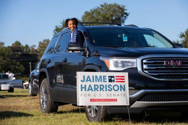 Braylen Washington waits for a drive-in campaign rally for Jaime Harrison to begin in North