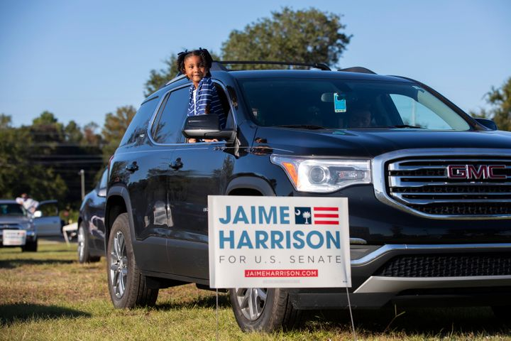 Braylen Washington waits for a drive-in campaign rally for Jaime Harrison to begin in North Charleston.