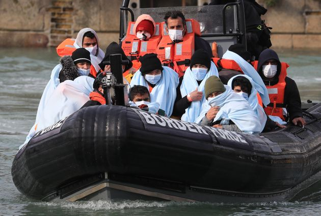 A group of people thought to be migrants are brought into Dover, Kent, by Border Force following a small...