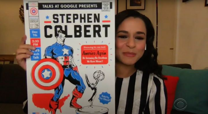 Sarah Cooper holds up the sign for Stephen Colbert's Google event.
