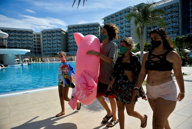 A family walks by the swimming pool at Varadero International Hotel in Matanzas Province, Cuba, on October...