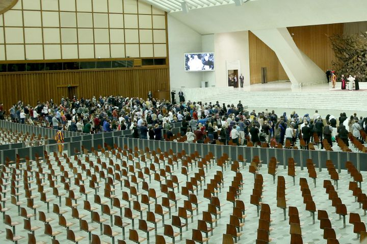 Pope Francis delivers his blessing to the faithful in a partially empty Paul VI Hall during his weekly general audience on Oc