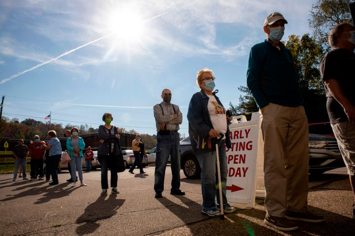 Early voters line up outside of the Vienna Community Building to cast their ballots for the Nov. 3 election, in Vienna, West