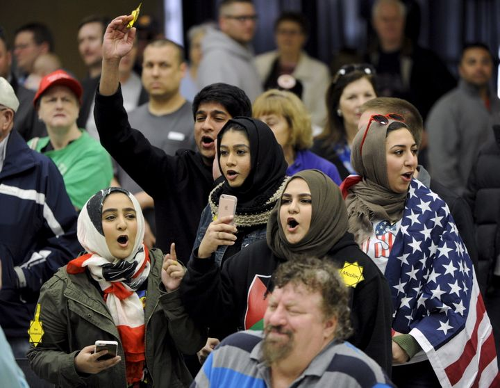 Young Muslims protest presidential candidate Donald Trump at a campaign rally in Wichita, Kansas, on March 5, 2016.