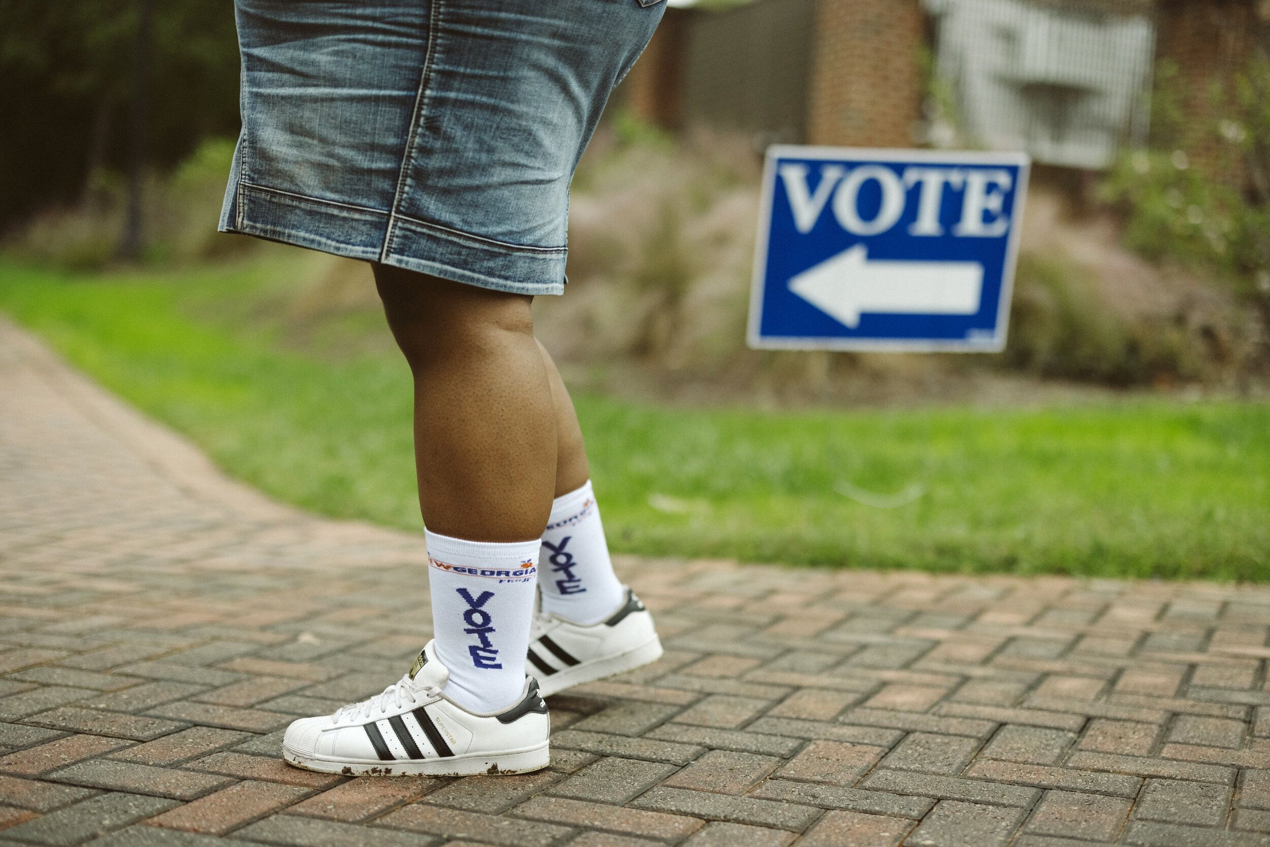 """Ría Thompson-Washington wears """"Vote"""" socks while posing for a portrait at Agnes Scott College in Decatur, Georgia, on"""