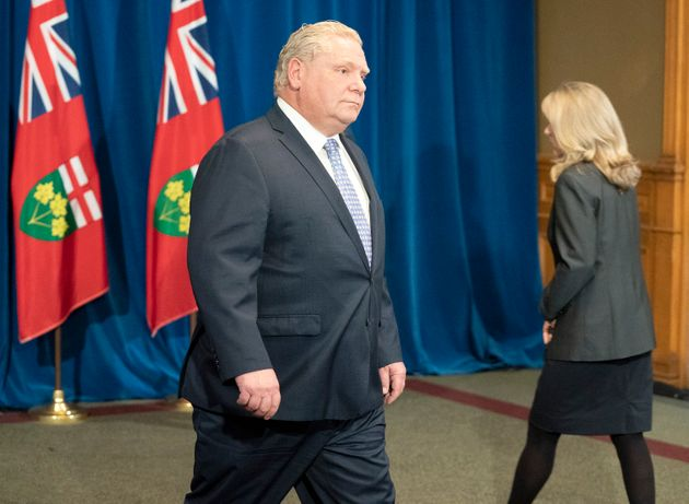 Ontario Premier Doug Ford passes Minister of Long-Term Care Merrilee Fullerton during the government's...