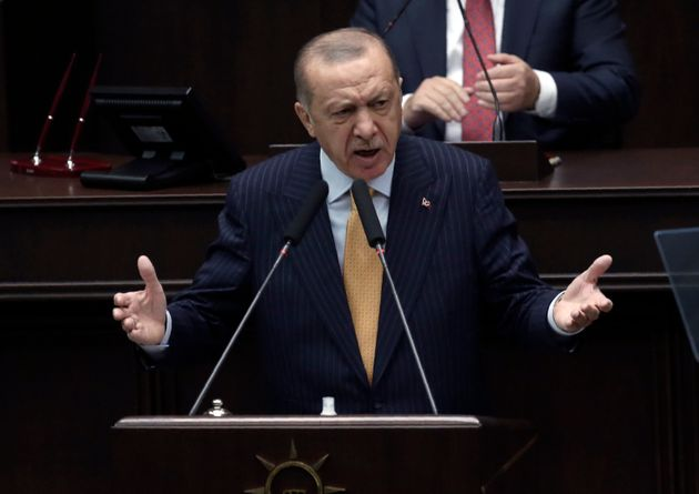 Turkey's President Recep Tayyip Erdogan addresses his ruling party lawmakers at the parliament, in Ankara,...