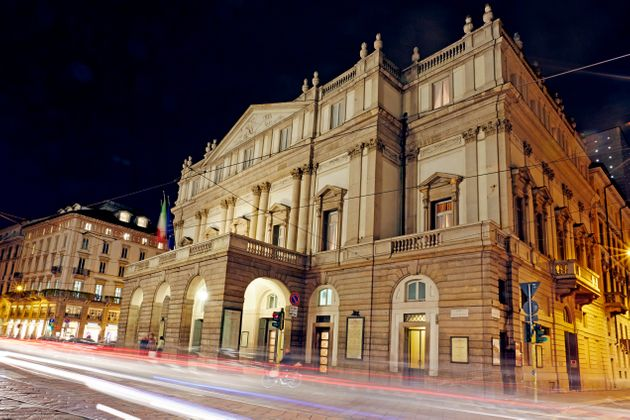 Front facade of 'Teatro alla Scala' illuminated at night. This world renowned opera house was inaugurated...