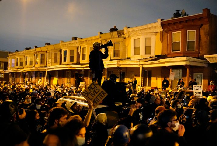 Protesters confront police during a march Tuesday Oct. 27, 2020 in Philadelphia. Hundreds of demonstrators marched in West Ph