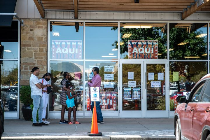 AUSTIN, TX - OCTOBER 13: Voters wait in line at a polling location on October 13, 2020 in Austin, Texas. The first day of vot