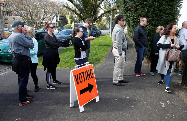 Voters wait outside a polling station in Auckland, New Zealand, in this file photo from Sept. 23, 2017....