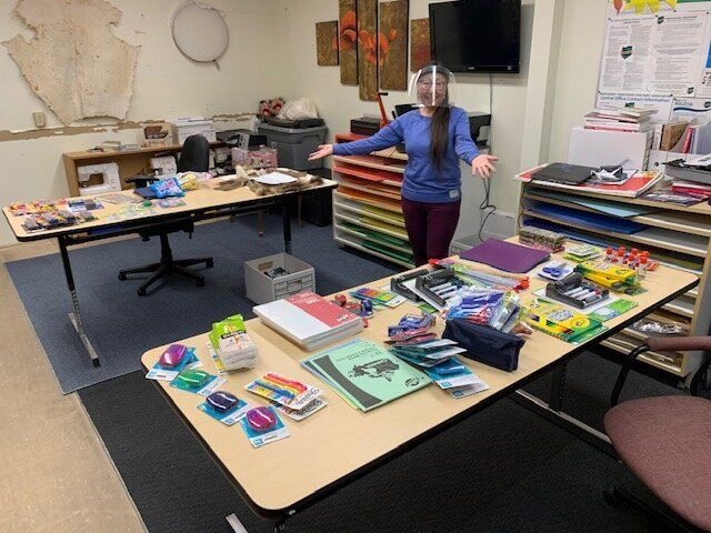 """A teacher at Helen Kalvak School in Nunavut with school supplies donated from Facebook group """"Help for Remote Northern Communities."""""""