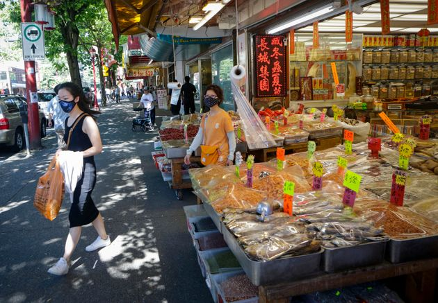 Customers shop during the COVID-19 pandemic in Chinatown of Vancouver, B.C., on July 20,
