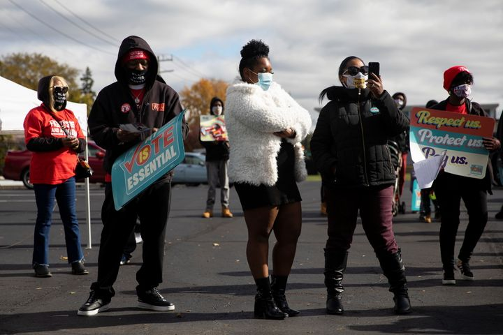 """Fast-food and nursing home workers gather during a """"My Vote is Essential"""" rally before casting their early ballots at Wayne County Community College in Detroit on Oct. 24."""