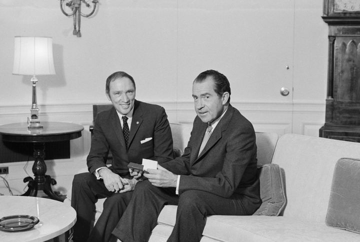 Archive photo of prime minister Pierre Trudeau and U.S. president Richard Nixon posing for picture on a sofa in the Chief Executive's office on March 24, 1969.