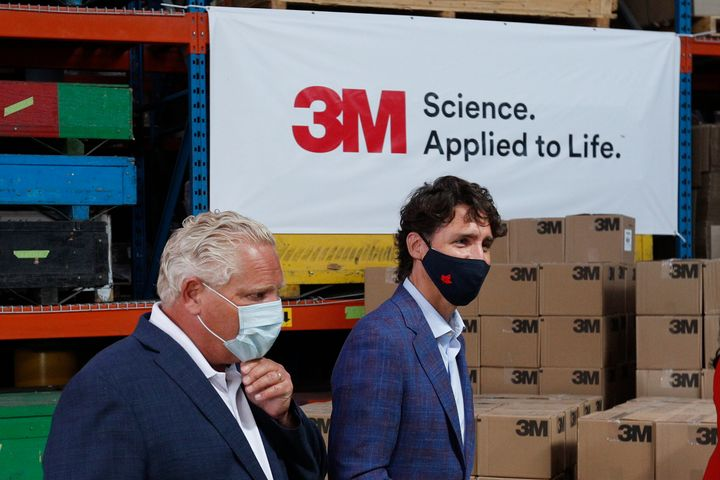 Ontario Premier Doug Ford and Prime Minister Justin Trudeau leave after an announcement at the 3M plant in Brockville, Ont. on Aug 21, 2020.