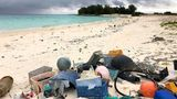 FILE - In this Oct. 22, 2019, photo, plastic and other debris sits on the beach on Midway Atoll in the Northwestern Hawaiian Islands. According to a study released on Friday, Oct. 30, 2020, more than a million tons a year of America's plastic trash isn't ending up where it should. The equivalent of as many as 1,300 plastic grocery bags per person is landing in places such as oceans and roadways. (AP Photo/Caleb Jones)