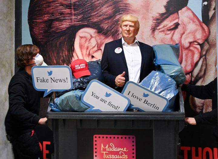 The wax figure of President Donald Trump is pushed in a garbage container at Madame Tussauds Berlin.
