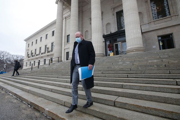 Dr. Brent Roussin, Manitoba chief public health officer, leaves after speaking at the province's latest...