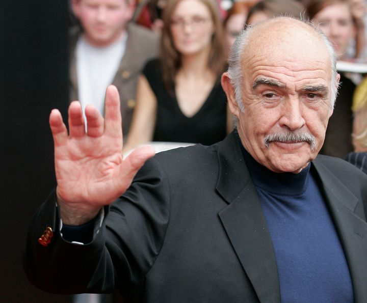 Sean Connery waves as he arrives to receive the Bafta Scotland Lifetime Achievement Award in Edinburgh, Scotland August 25, 2006.