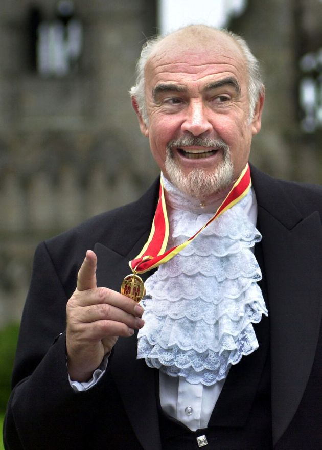 Sean Connery, donning full Highland dress and wearing his medal after he was formally knighted by the...