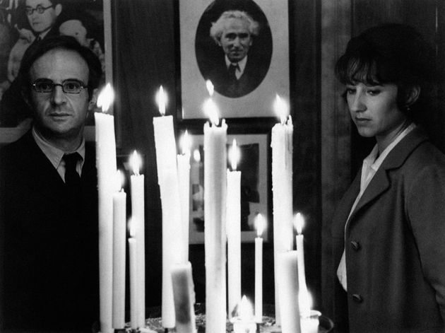 French director and actor Francois Truffaut and French actress Nathalie Baye meditating in front of some...