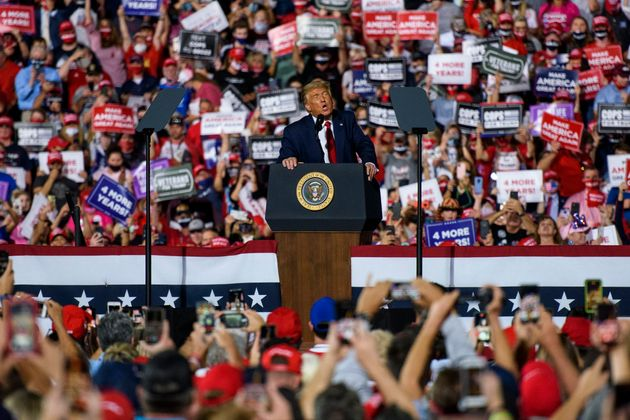 President Donald Trump addresses a crowd of several thousand rallygoers in Gastonia, North Carolina,...