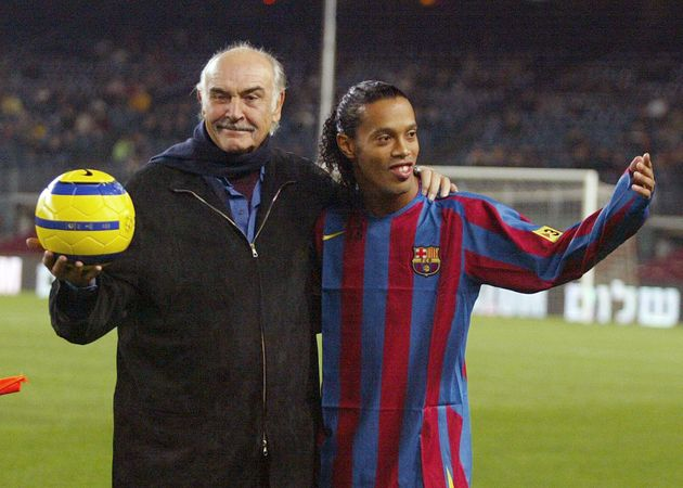 British actor Sean Connery (L) stands with Brazilian player Ronaldinho after making a ceremonial kick...
