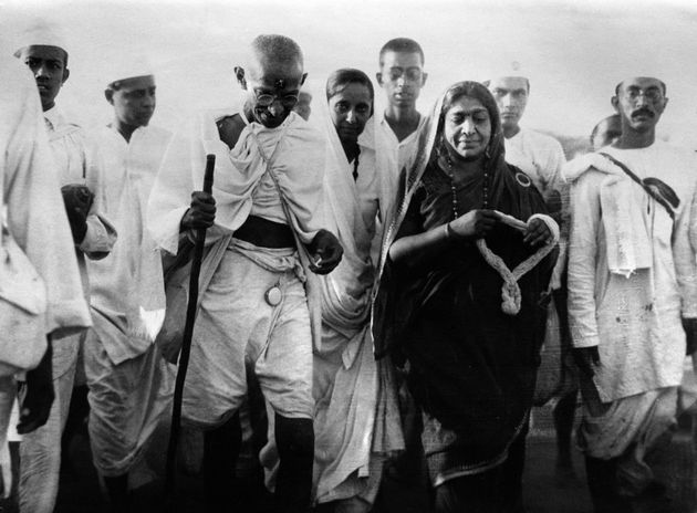 Mahatma Gandhi and Mrs Sarojini Naidu, poetess and politician, on their way to break the state laws at Dandi, India, on 24 April, 1930.