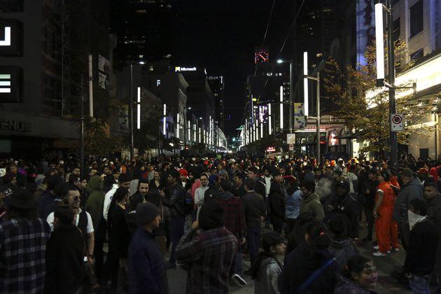 People celebrate Halloween on Granville Street in Vancouver, B.C. on October 31,