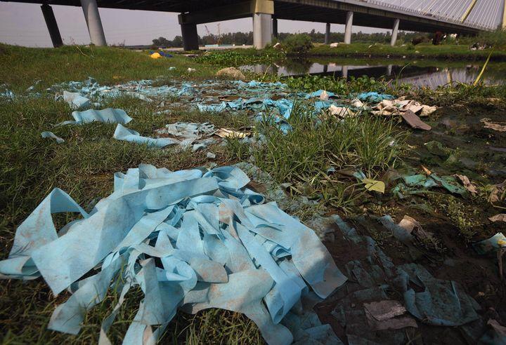 Biomedical waste dumped near the Yamuna river near Signature Bridge on July 27, 2020 in New Delhi.