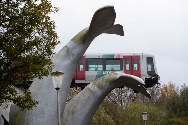 The whale's tail of a sculpture caught the front carriage of a metro train as it rammed through the end...