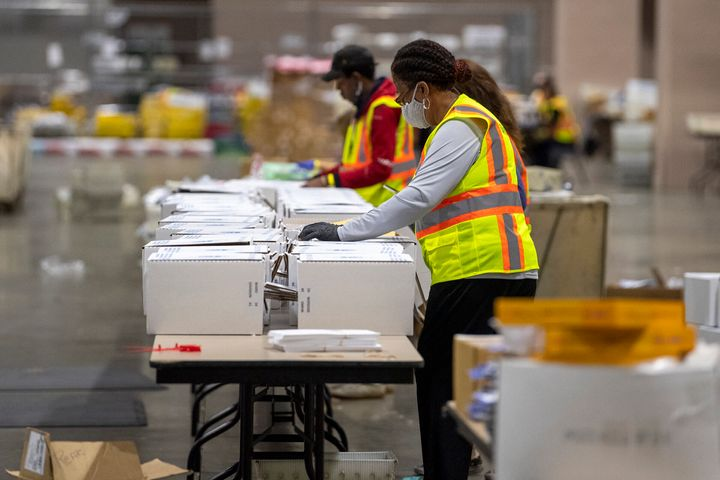 Workers are shown during a media tour highlighting the preparations for the sorting and counting of mail-in ballots at the Pe