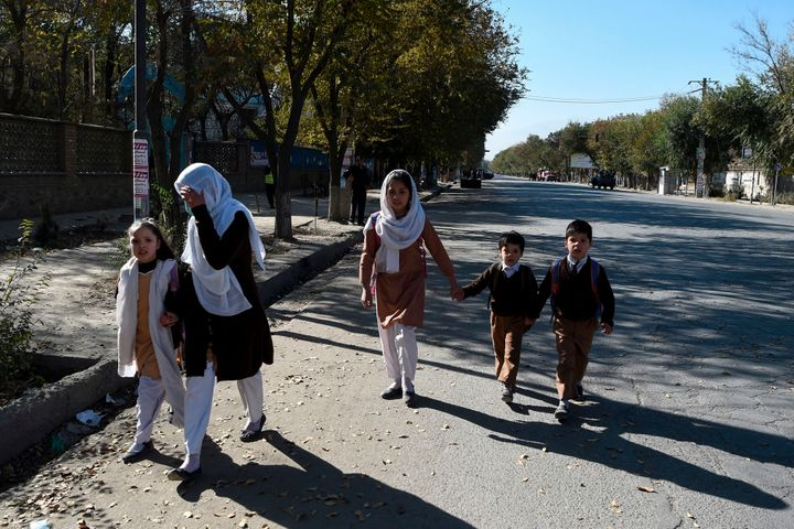 School children walk along a road near Kabul University in Kabul on November 2, 2020. (Photo by WAKIL KOHSAR/AFP via Getty Im