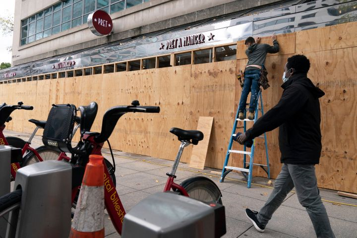 A Pret A Manger restaurant in downtown Washington, not far from the White House, is seen being boarded up on Friday ahead of