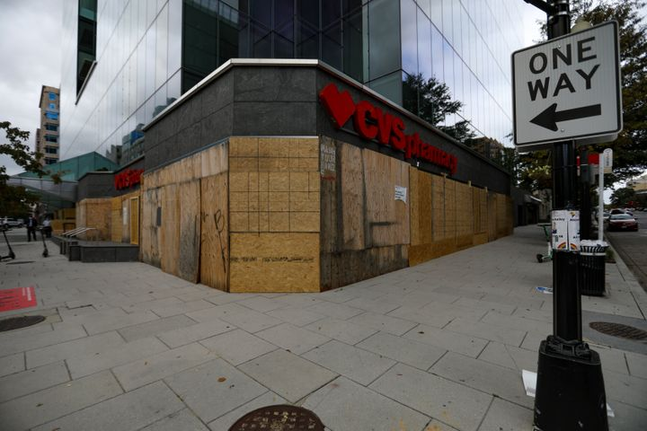 Retailers have been boarding up their stores ahead of Tuesday's election. A boarded-up CVS store in Washington, D.C., is pict