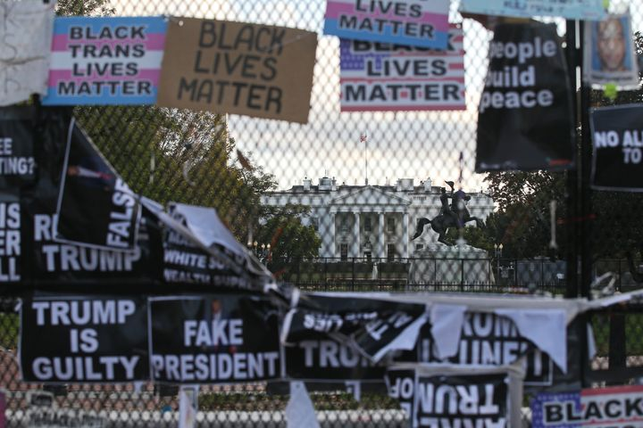 A White House fence covered with placards against Donald Trump's re-election is seen ahead of Tuesday's election.