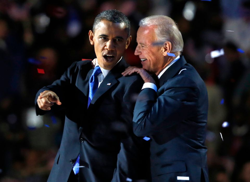 Obama gestures with Joe Biden after his election night victory speech in Chicago in