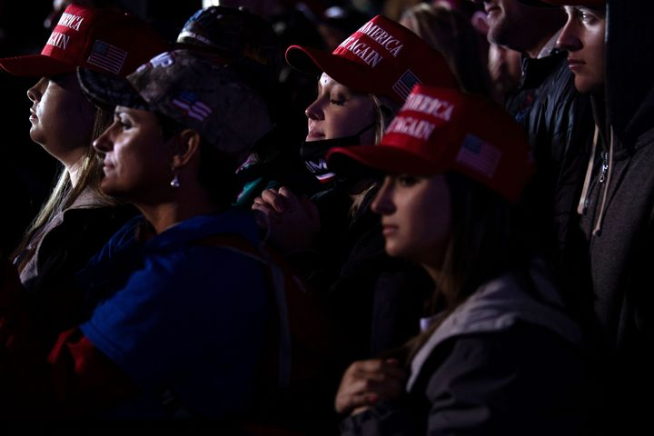 People listen while President Donald Trump speaks during a rally at Richard B. Russell Airport in Rome, Georgia, on Nov. 1, 2