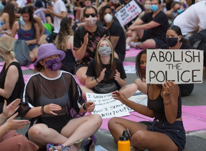 Hundreds of demonstrators congregate on College Street in front of Toronto Police Services HQ on June 19, 2020.<br />