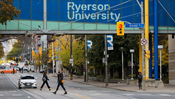 Students walk below a Ryerson University sign in Toronto, Canada, on Oct. 20, 2020.
