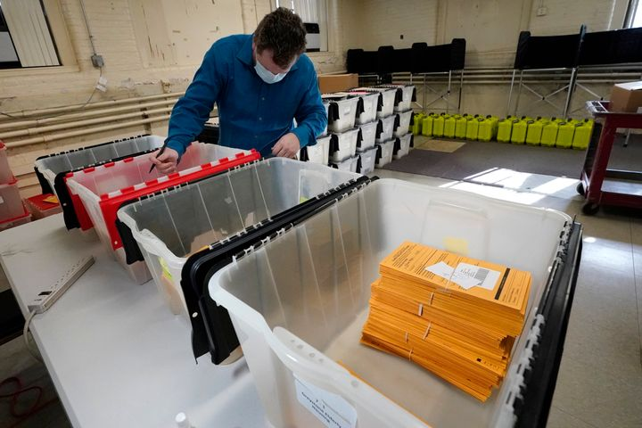 Assistant City Clerk James Blatchford prepares absentee and early vote ballots at Haverhill City Hall to be sent to precincts for Election Day counting, Monday, Nov. 2, 2020, in Haverhill, Massachusetts.