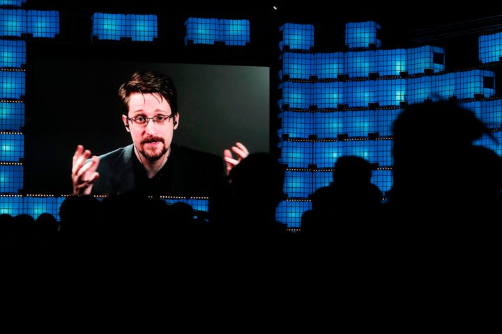 Former U.S. National Security Agency contractor Edward Snowden is seen addressing attendees through video link at a technolog