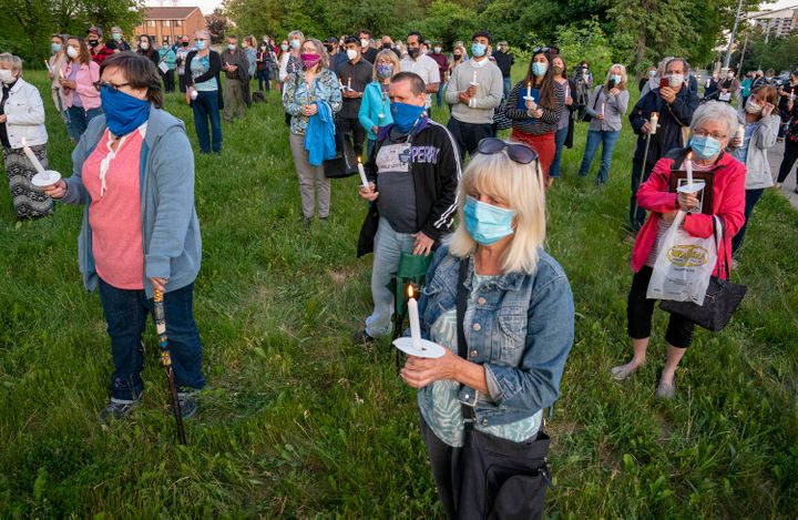 Community members hold a vigil for COVID-19 victims at the Orchard Villa long-term care home in Pickering, Ont. on June 15, 2020.